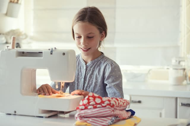 basic life skills for kids- a girl sewing