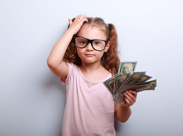 basic life skills for kids- girl with money
