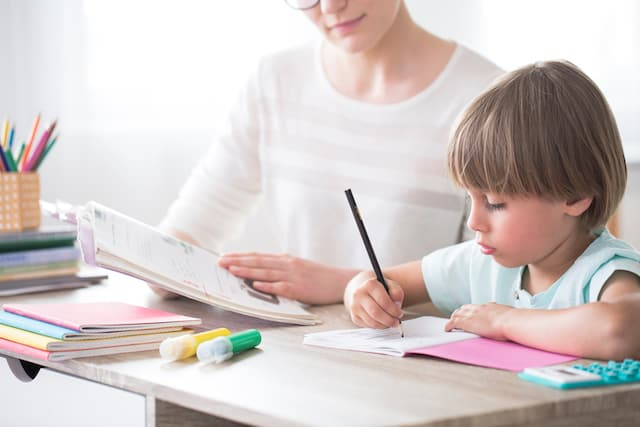 child studying with mom- how to teach your child to be independent