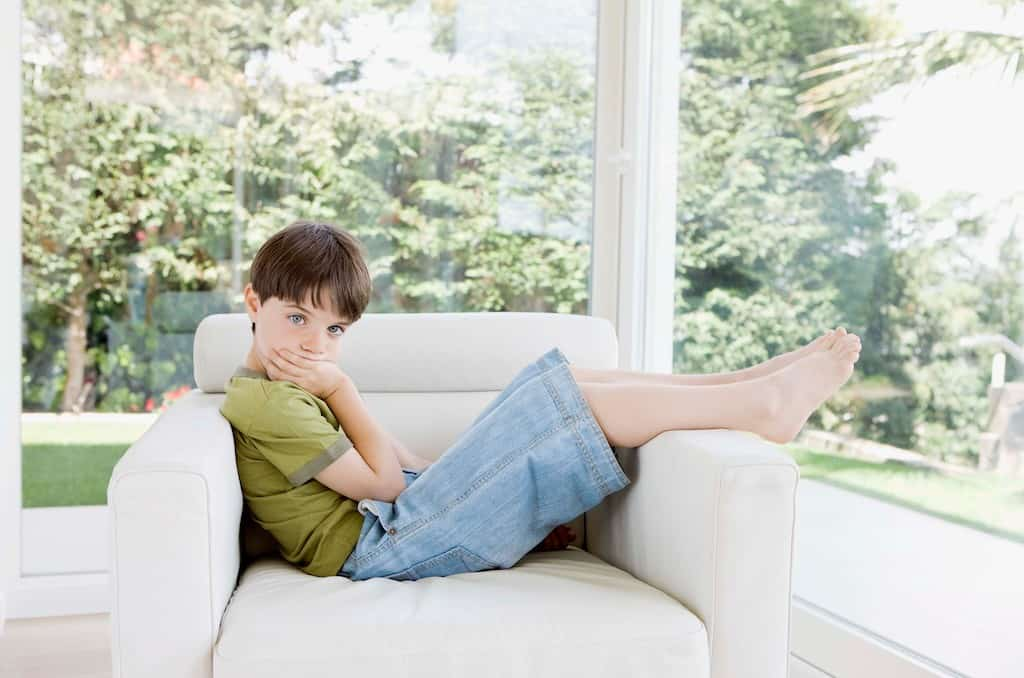 Boy sitting alone- how to stop sibling rivalry