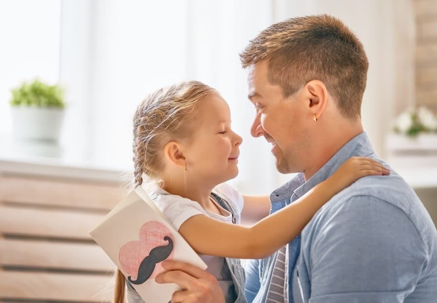 Loving dad talking to daughter