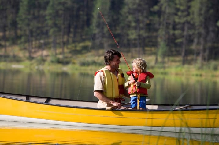 Dad speaking positively to child while fishing