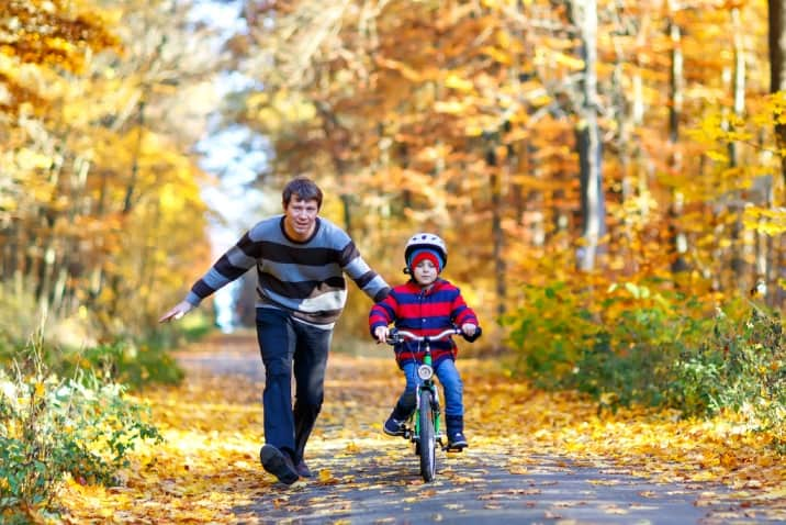 Dad training son to bike