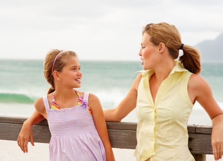 mom speaking encouraging words to daughter