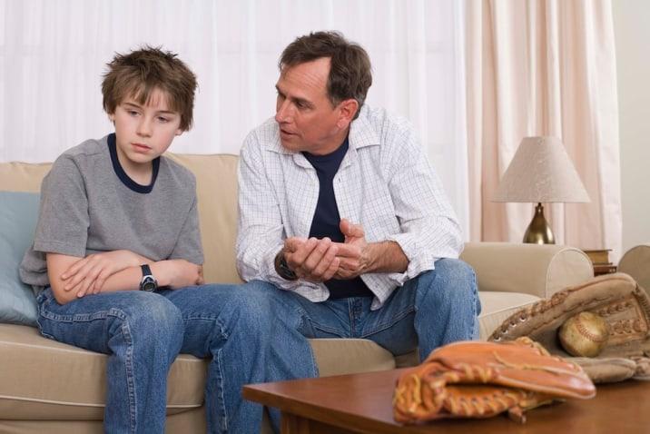 Dad disciplining son positively