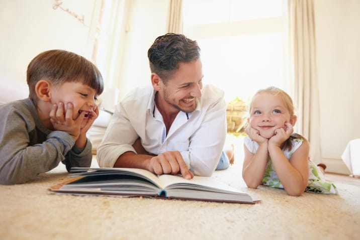 A father reading to children and using quality time to connect with them