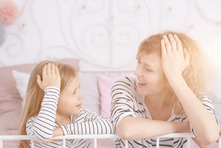 Mom talking to daughter in a happy mood