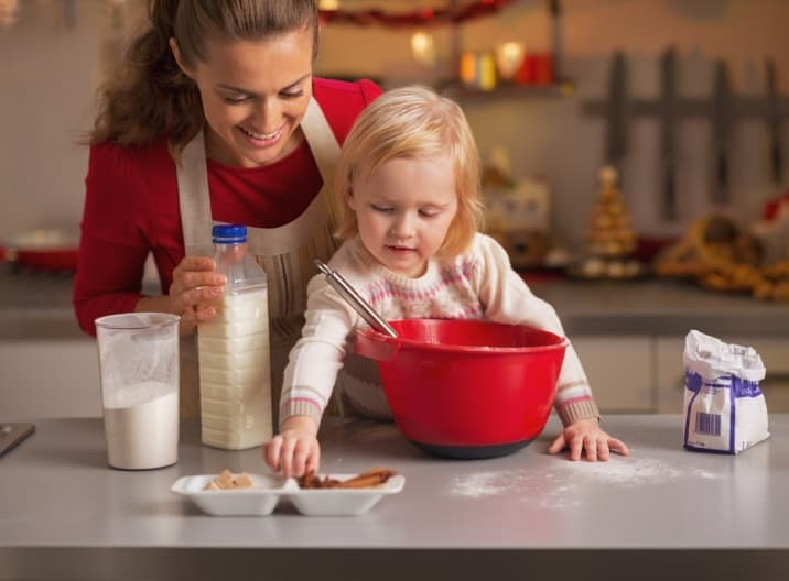 Daughter helping mom to make cookies. One of the bad habits of mom is not asking for help