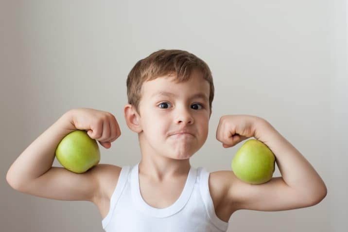 A boy showing his muscles