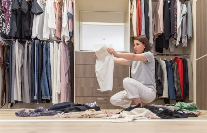 a woman who has no space in wardrobe - how to stop accumulating clutter
