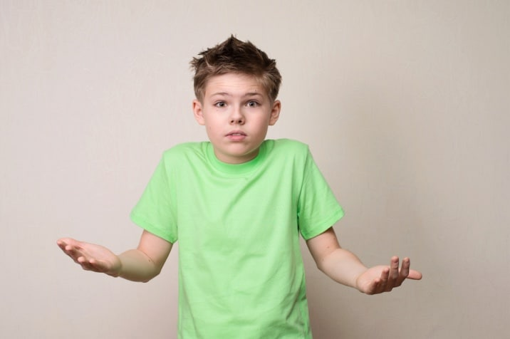 confused boy - why do kids misbehave